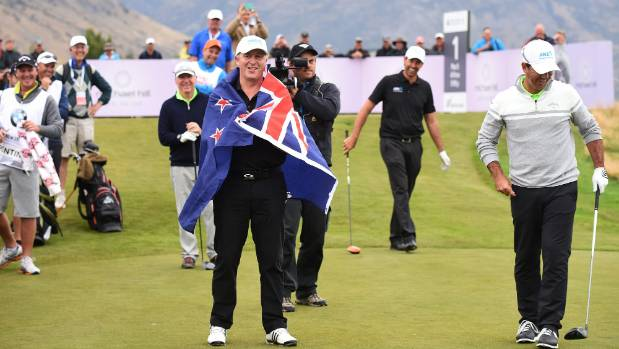 Prime Minister John Key wore the New Zealand flag after Ricky Ponting pulled it out at the New Zealand Open in Queenstown.