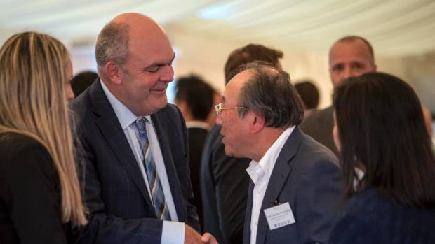 Economic Development Minister Steven Joyce speaks with Japanese businessman Takashi Numata at a business friendship ...
