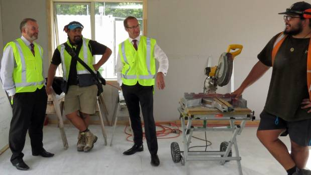 Hutt South MP Trevor Mallard, construction tutor Len Matautia and Opposition Andrew Little talk to WelTec construction ...
