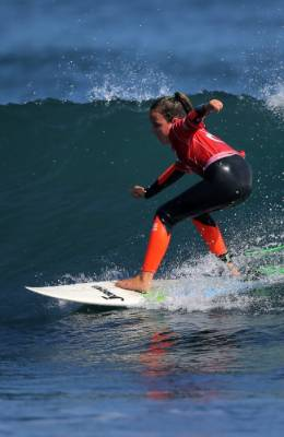 Sophie Brock, 9, of Mt Maunganui rides the face of a wave during the under-12 girls' semi-final.