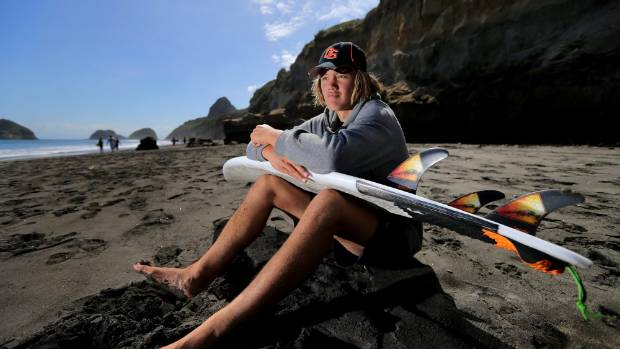 Waitara's Reef Matthews keeps an eye on the swell at New Plymouth's Back Beach before the under-17 boys' final of the ...