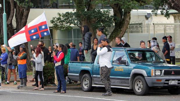 Protestors and members of the public outside Hawera District Court during a protest in 2016.