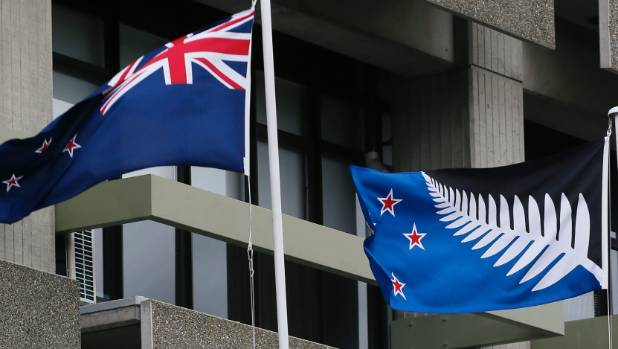 The New Zealand flag, left and the alternative flag design fly outside Civic House.