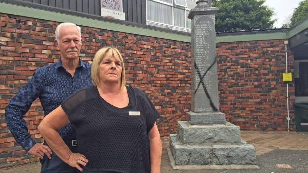 Titirangi RSA committee members Rex Baddeley, left, and Jackie McDermott are shocked to see the graffiti on a memorial ...