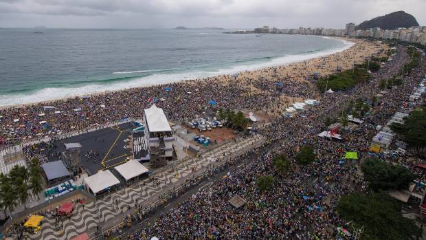 People gather at Copacabana beach to hear Pope Francis celebrate mass on July 25, 2013. Martin Peat assisted the ...