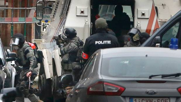 Television footage showed black-clad security forces wearing balaclavas guarding a street.