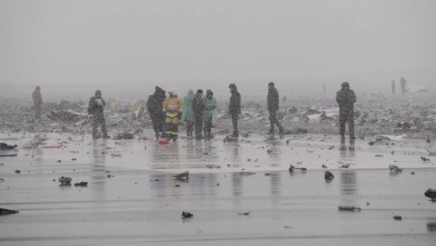 Emergencies Ministry members and investigators work at the crash site