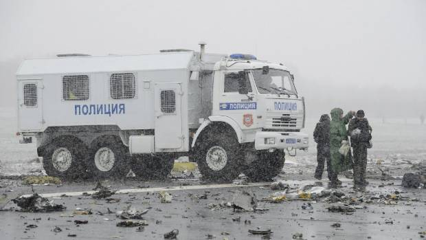 A police truck is seen at the crash site.