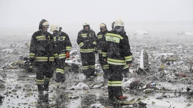 Emergencies Ministry members work at the crash site.