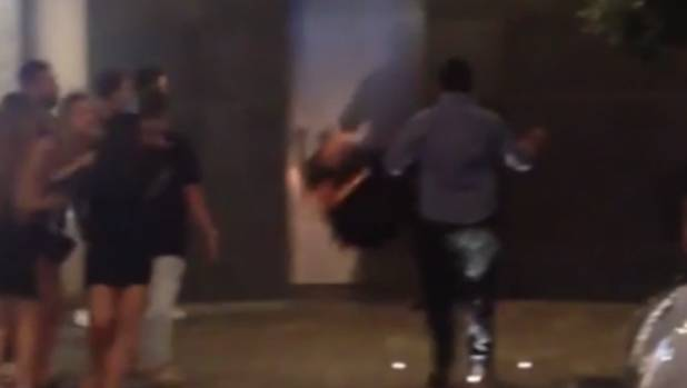 A person is thrown to the ground during one of several brawls in Auckland overnight on Saturday.