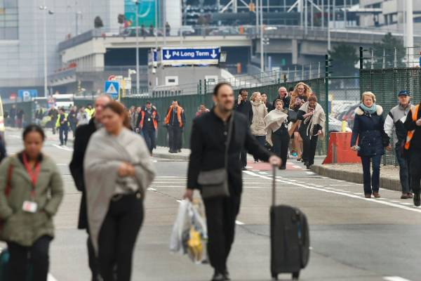 People are evacuated from Zaventem Airport after the blasts.