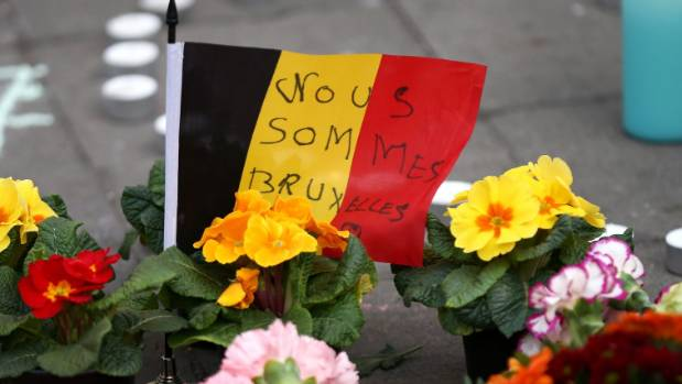 Tributes are left at the Place de la Bourse following Tuesday's terrorism attacks in Brussels, Belgium.