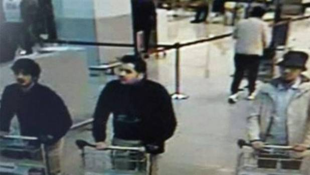 Police have released a CCTV image of possible suspects in the bombing of the airport.