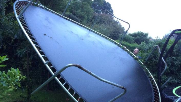 This storm-tossed trampoline, flew over hedge from a neighbouring property, Mt Albert, Auckland.