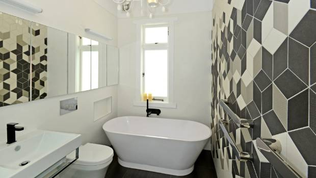 a mix of black grey and neutral diamond tiles from patricia urquiola feature in this - Renovated Bathrooms Pictures