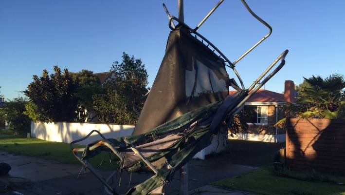 A trampoline smashed against a lamppost after a tornado in Mount Maunganui last year.