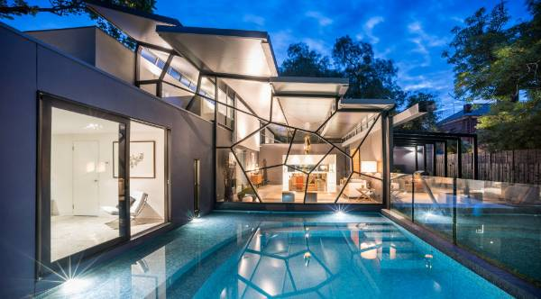 Architect Craig Rossetti designed this house for his own family. The glass curtain wall appears to be cracking under the ...
