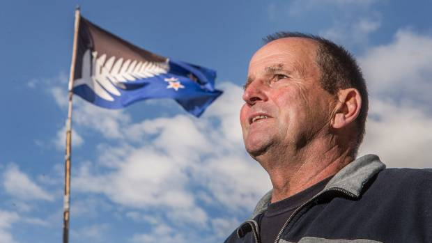 """Pete McCrea with the Lockwood flag still flying outside his Christchurch home: """"Maybe I should leave it up."""""""