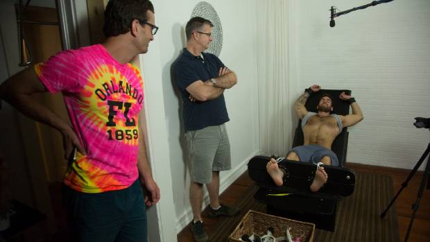David Farrier, left, in a scene from Tickled.