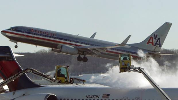 The American Airlines pilot was held at a security checkpoint after he allegedly tested above the legal limit for blood ...