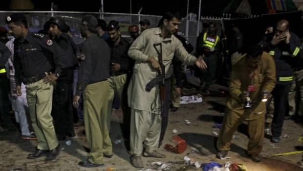 Security officials gather at the the park in Lahore.