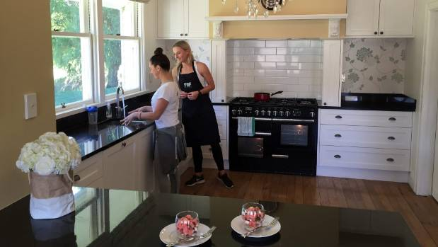 Angela Lee, left, and Hannah Mai Dodd prepare food for guests at Queenstown Fitness Retreats.
