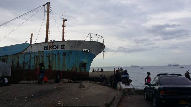 A rusting ship sits idly by the shore near the Central Market in Honiara, Solomon Islands.