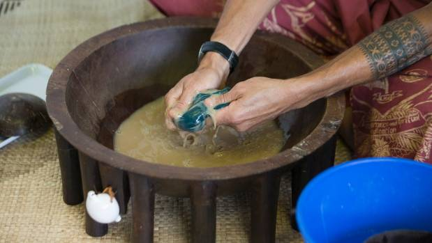 Kava is prepared in a traditional kava bowl.