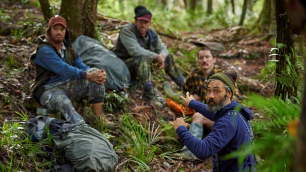 Taika Waititi on set with Stan Walker, Mike Minogue and Cohen Holloway, who play a trio of hunters in his movie Hunt for ...