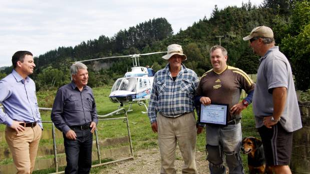 CAA safety investigation manager Jim Burtenshaw, left, presented a Down to the Wire certificate to Tarata sheep and beef ...