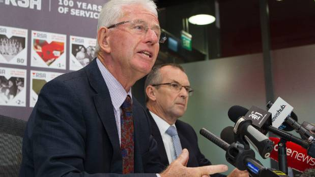 Chairman of NZ Post Sir Michael Cullen, left makes an announcement on the ownership of Kiwi Bank with chief executive ...
