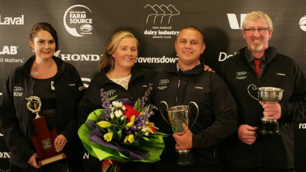 West Coast/Top of the South Dairy Industry Awards winners, Renee Mason and Jesse Huffam,  are flanked by Del Bruce, the ...