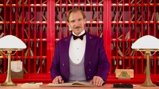 Ralph Fiennes as Gustave H, the legendary concierge at The Grand Budapest Hotel.