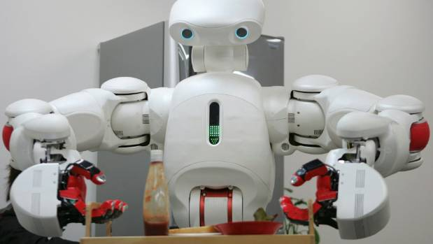Twendy-One, a robot designed to help the elderly and disabled people around the house, demonstrates carrying a food tray.