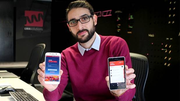 LWA Solutions chief executive Atta Elayyan shows off the cell phone app that allows courier firms to quickly increase ...