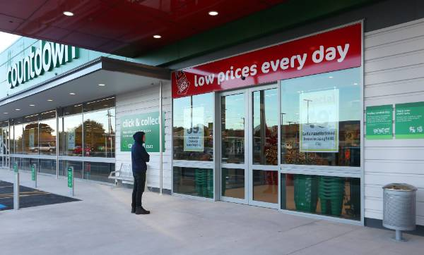 A customer waits for the store to open at 7.30am.