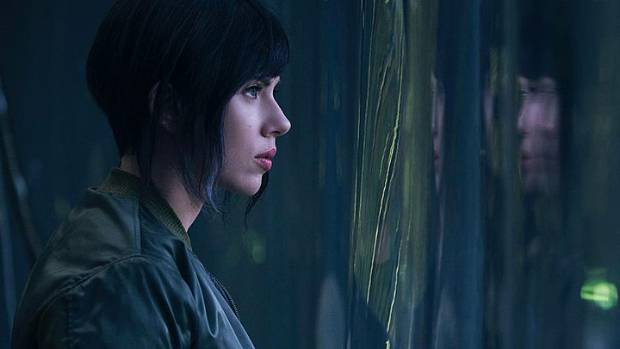 "Johansson stars in the film as a character with a human brain in a completely bionic body, hence the ""ghost"" in the ""shell""."