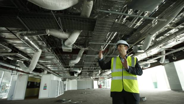 BNZ recovery manager Richard Griffiths inside the damaged building in October 2013. Air conditioning ducts, wiring ...