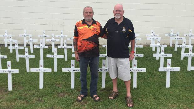 Bob Gage, left, and Greg Hartley hand placed each of the 91 crosses outside the entrance of the Birkenhead RSA.