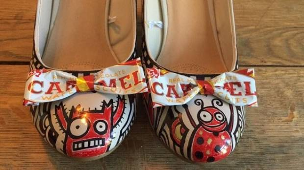 Liz Pichon wears customised Tom Gates shoes when visiting schools.