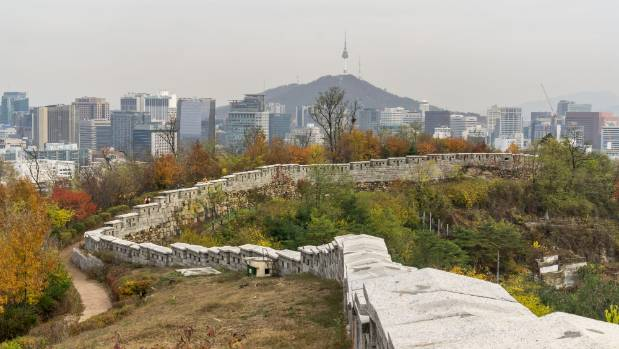 Seoul Tower looks out over the Seonggwak fortress wall.