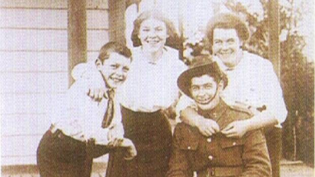 """John """"Jack"""" Snell is pictured here outside his family home in Christchurch, with (from left) his brother George and ..."""