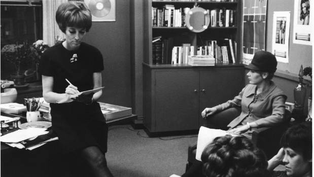 Gurley Brown leads a Cosmopolitan staff meeting in the mid-60s.
