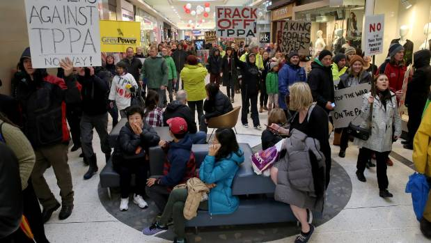 Bemused shoppers: Christchurch anti-TPPA protest marches through Westfield Mall.