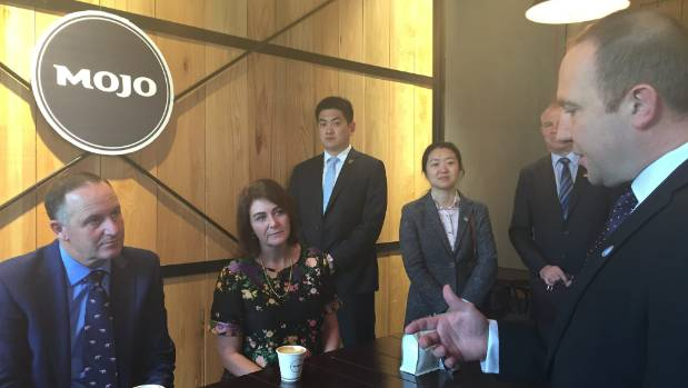 Prime Minister John Key (left) visits China's first Mojo coffee shop, due to open at a New Zealand business hub in Xi'an ...