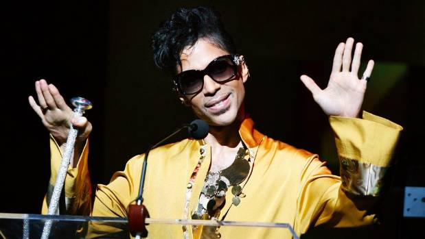 Musician Prince gestures on stage during the Apollo Theatre's 75th anniversary gala in New York, June 8, 2009.