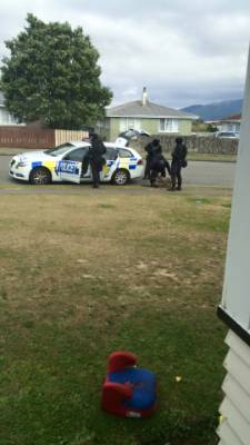 Armed police at the standoff in Kokiri Cres, Porirua.