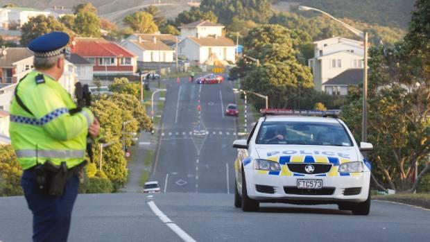 Police swarm Warspite Ave, Porirua, near Kokiri Cres, where Pita Te Kira had shot police dog Gazza dead.