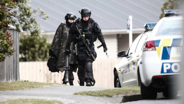 Police leaving the scene of the siege in Porirua last April.