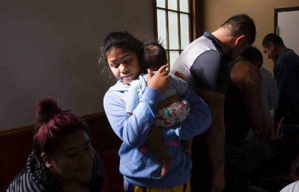 Porirua residents evacuated to Horouata Marae overnight. Nakita Siala, 14 holding her baby niece Alpha Feo.
